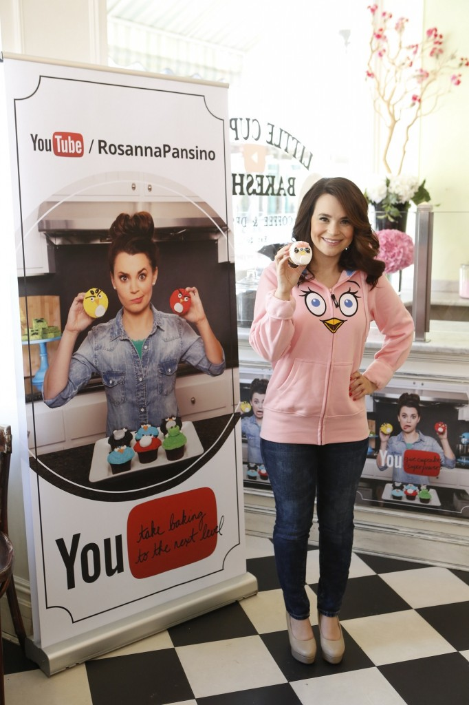 Rosanna Pansino infront of The Youtube Sign at The Little Cupcake Bakeshop Youtube Angry Birds Event